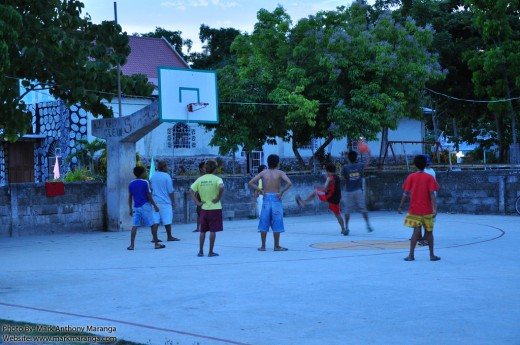 Teenagers playing at the Basketball Court