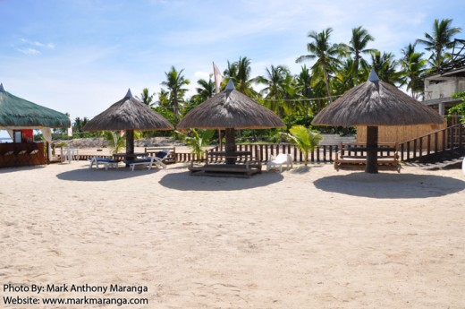 Tropical Huts on the white-sand beach