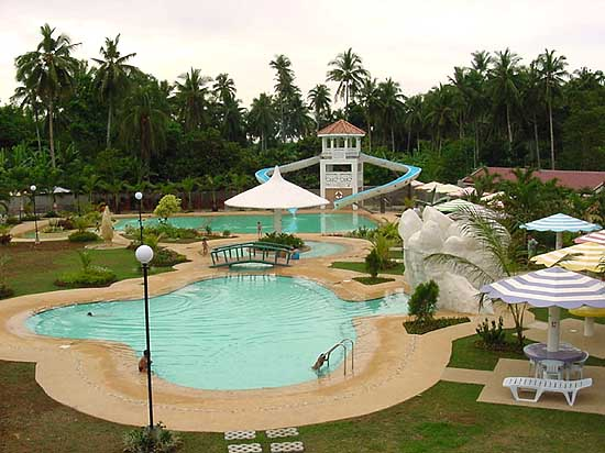 Tubod a swimming pool of flowing waters in minglanilla for Pool garden mountain resort argao