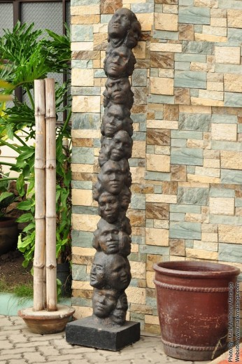 Hand-made wood carving of many faces