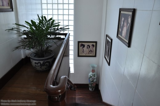 Stairway with Pictures and Porcelain