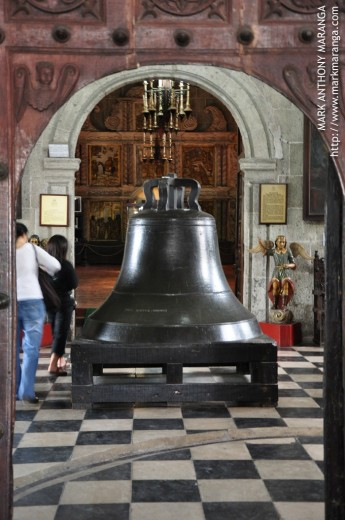 The large bell inside the San Agustin Museum