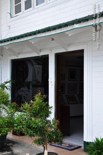 Entrance door with paintings inside