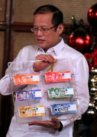 President Aquino showcasing the new bills