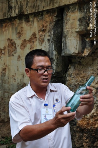 Armand (Tour Guide) Showing an Old Coca Cola Bottle
