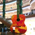 Big Guitar covered with Flowers