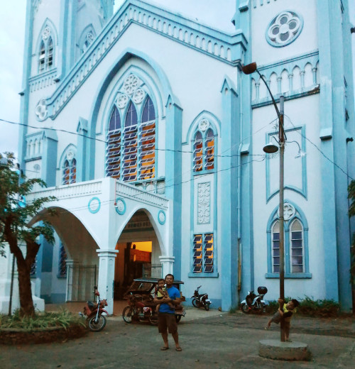 At the facade of the Palawan Cathedral